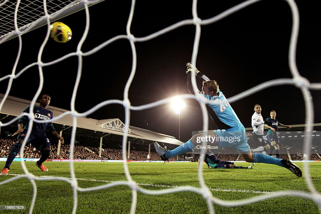 Goalkeeper Simon Mignolet of Sunderland dives in vain as <a gi-track='captionPersonalityLinkClicked' href=/galleries/search?phrase=Mladen+Petric&family=editorial&specificpeople=699883 ng-click='$event.stopPropagation()'>Mladen Petric</a> of Fulham scores his team's goal during the Barclays Premier League match between Fulham FC and Sunderland AFC at Craven Cottage on November 18, 2012 in London, England.