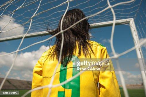 Goalkeeper standing in goalpost