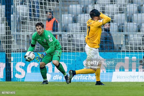 goalkeeper Stefan Ortega of TSV 1860 Muenchen and Pascal Testroet of Dynamo Dresden battle for the ball during the Second Bandesliga match between...