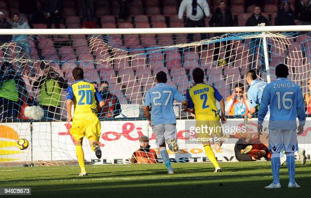 Goalkeeper Stefano Sorrentino of Chievo fails to stop Marek Hamsik of SSC Napoli scoring the opening goal from a penalty during the Serie A match...