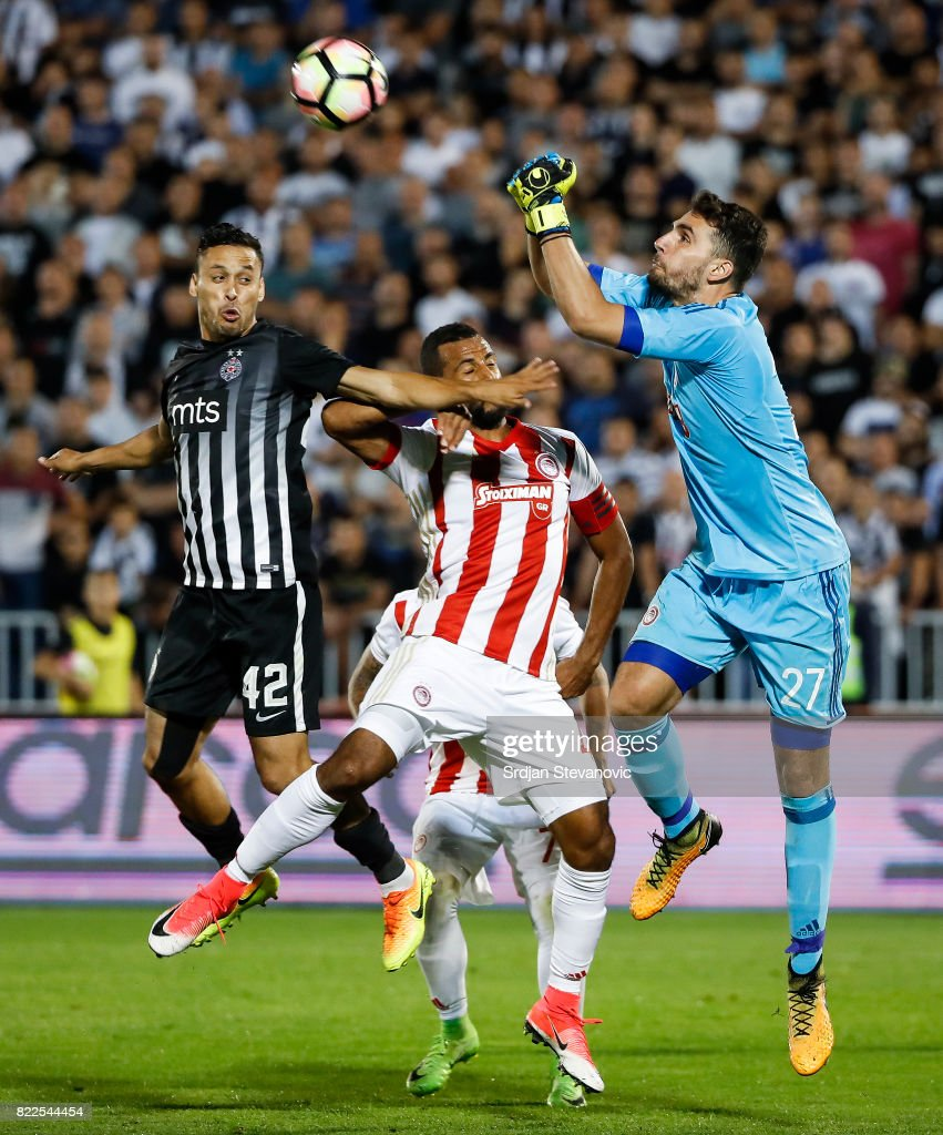 Goalkeeper Stefanos Kapino (R) of Olympiacos jumps for the ball against Leonardo (L) of Partizan during the UEFA Champions League Qualifying match between FC Partizan and Olympiacos on July 25, 2017 in Belgrade, Serbia.