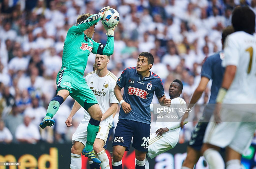 Goalkeeper <a gi-track='captionPersonalityLinkClicked' href=/galleries/search?phrase=Steffen+Rasmussen&family=editorial&specificpeople=12954244 ng-click='$event.stopPropagation()'>Steffen Rasmussen</a> of AGF Aarhus saves the ball during the Danish Alka Superliga match between FC Copenhagen and AGF Aarhus at Telia Parken Stadium on May 29, 2016 in Copenhagen, Denmark.