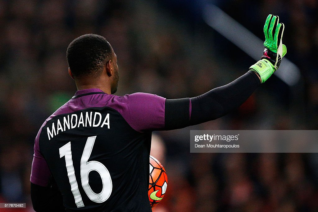 Goalkeeper Steve Mandanda of France speaks to team mates during the International Friendly match between Netherlands and France at Amsterdam Arena on...