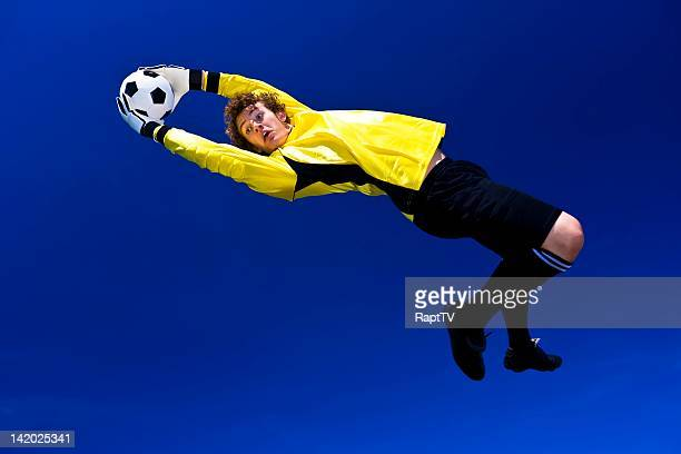 Goalkeeper stretches to make the save