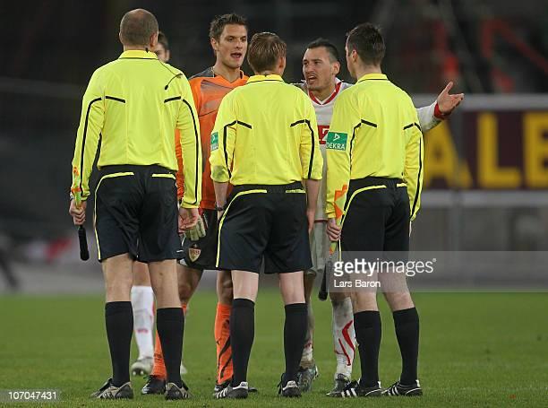 Goalkeeper Sven Ulreich and Timo Gebhart of Stuttgart discuse with referee Christian Dingert after loosing the Bundesliga match between VfB Stuttgart...