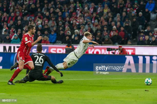 Goalkeeper Sven Ulreich of Bayern Muenchen fouls Felix Klaus of Hannover during the Bundesliga match between FC Bayern Muenchen and Hannover 96 at...