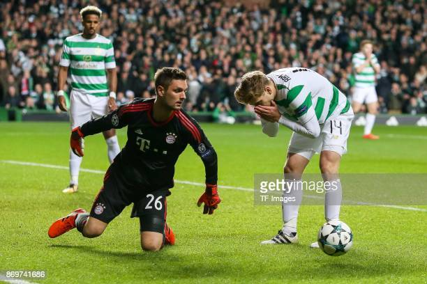 Goalkeeper Sven Ulreich of Bayern Munich and Stuart Armstrong of Celtic in action during the UEFA Champions League group B match between Celtic FC...