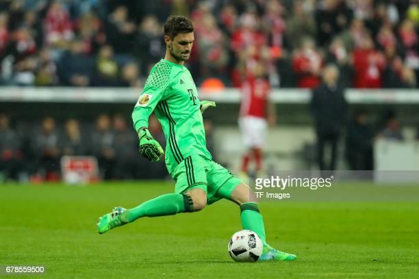 Goalkeeper Sven Ulreich of Bayern Munich controls the ball during the German Cup semi final soccer match between FC Bayern Munich and Borussia...