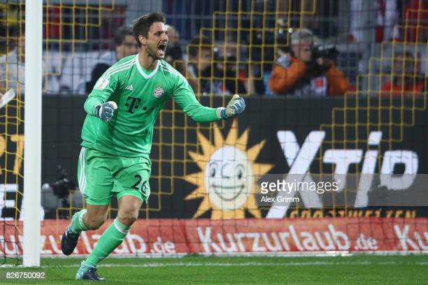 Goalkeeper Sven Ulreich of Muenchen celebrates after saving the decisive penalty during the penalty shootout of the DFL Supercup 2017 match between...