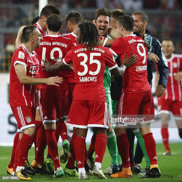 Goalkeeper Sven Ulreich of Muenchen celebrates with team mates after the penalty shootout of the DFL Supercup 2017 match between Borussia Dortmund...