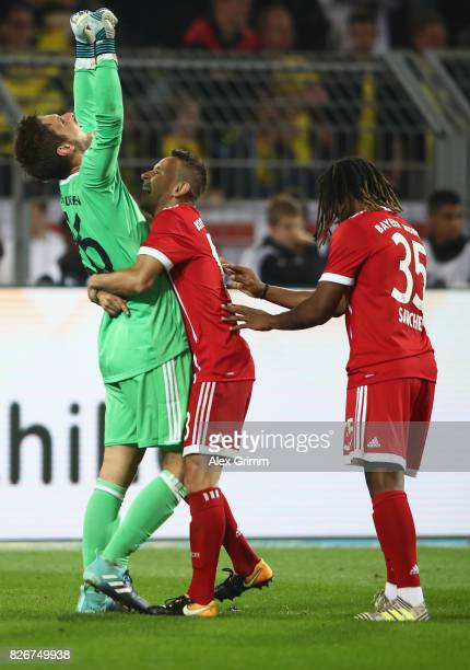 Goalkeeper Sven Ulreich of Muenchen celebrates with team mates Rafinha and Renato Sanches after the penalty shootout of the DFL Supercup 2017 match...