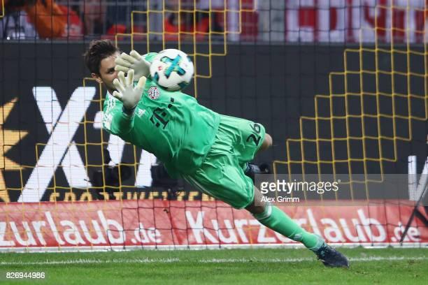 Goalkeeper Sven Ulreich of Muenchen saves a penalty from Sebastian Rode of Dortmund during the penalty shootouot of the DFL Supercup 2017 match...