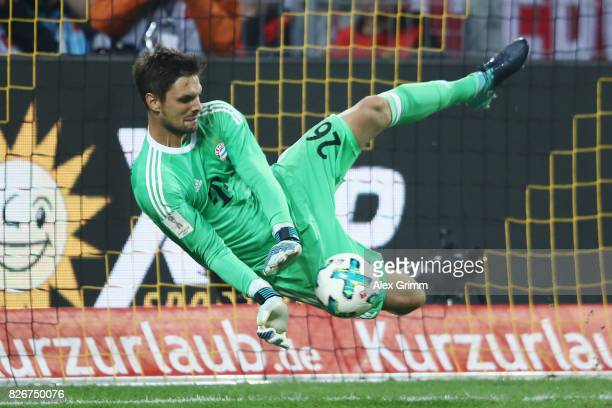 Goalkeeper Sven Ulreich of Muenchen saves the decisive penalty during the penalty shootout of the DFL Supercup 2017 match between Borussia Dortmund...