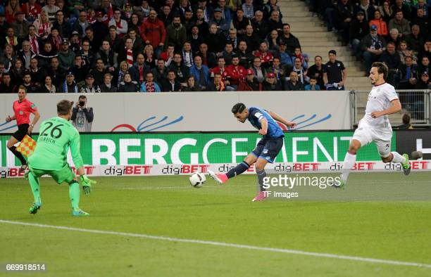 Goalkeeper Sven Ulreich of Munich and Nadiem Amiri of Hoffenheim and Mats Hummels of Munich battle for the ball during the Bundesliga match between...