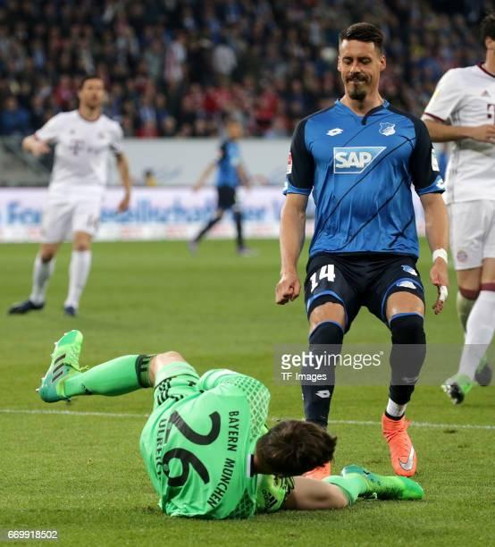 Goalkeeper Sven Ulreich of Munich and Sandro Wagner of Hoffenheim battle for the ball during the Bundesliga match between TSG 1899 Hoffenheim and...