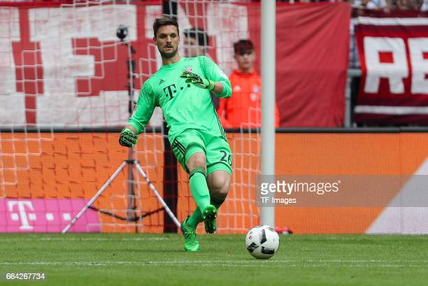 goalkeeper Sven Ulreich of Munich controls the ball during the Bundesliga match between Bayern Muenchen and FC Augsburg at Allianz Arena on April 1...
