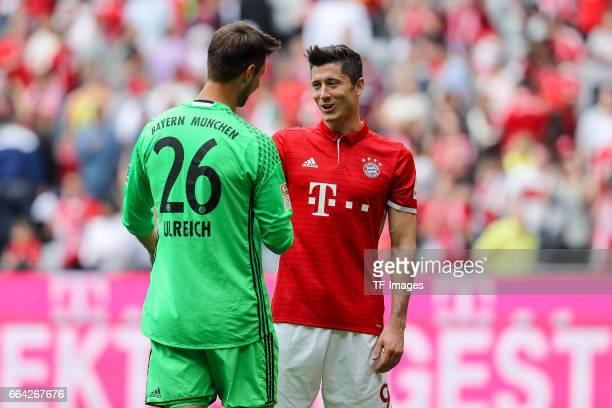 goalkeeper Sven Ulreich of Munich spek with Robert Lewandowski of Munich during the Bundesliga match between Bayern Muenchen and FC Augsburg at...