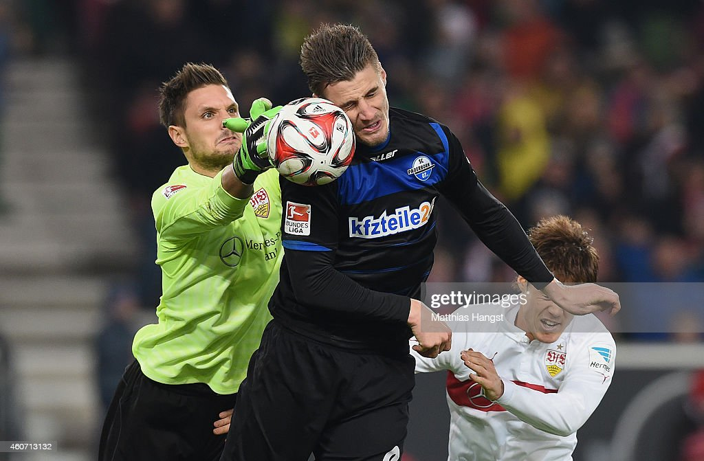 Goalkeeper Sven Ulreich of Stuttgart and Stefan Kutschke of Paderborn compete for the ball during the Bundesliga match between VfB Stuttgart and SC...