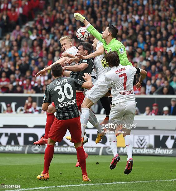 Goalkeeper Sven Ulreich of Stuttgart makes a safe against Marc Torrejon of Freiburg during the Bundesliga match between VfB Stuttgart and SC Freiburg...