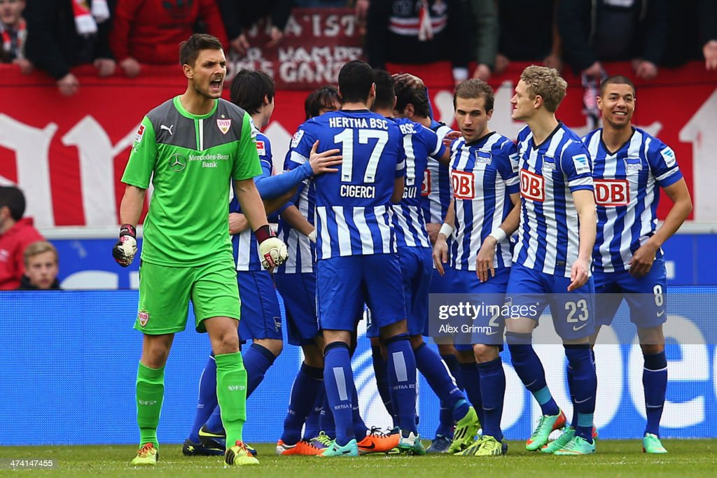 Goalkeeper <a gi-track='captionPersonalityLinkClicked' href=/galleries/search?phrase=Sven+Ulreich&family=editorial&specificpeople=4877030 ng-click='$event.stopPropagation()'>Sven Ulreich</a> of Stuttgart reacts as <a gi-track='captionPersonalityLinkClicked' href=/galleries/search?phrase=Levan+Kobiashvili&family=editorial&specificpeople=243110 ng-click='$event.stopPropagation()'>Levan Kobiashvili</a> (hidden) of Berlin celebrates his team's first goal with team mates during the Bundesliga match between VfB Stuttgart and Hertha BSC Berlin at Mercedes-Benz Arena on February 22, 2014 in Stuttgart, Germany.
