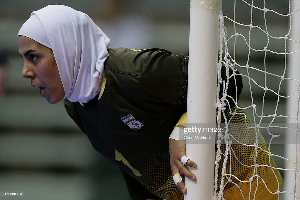 Goalkeeper Tavasoli Sis Farzaneh #1 of Iran gives instructions to team mates against Japan during the Women's Futsal Gold Medal match between Iran and Japan at Songdo Global University Campus Gymnasium during day seven of the 4th Asian Indoor & Martial Arts Games on July 5, 2013 in Incheon, South Korea.