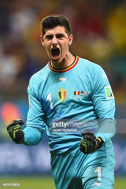 Goalkeeper Thibaut Courtois of Belgium celebrates his team's first goal in extra time during the 2014 FIFA World Cup Brazil Round of 16 match between...