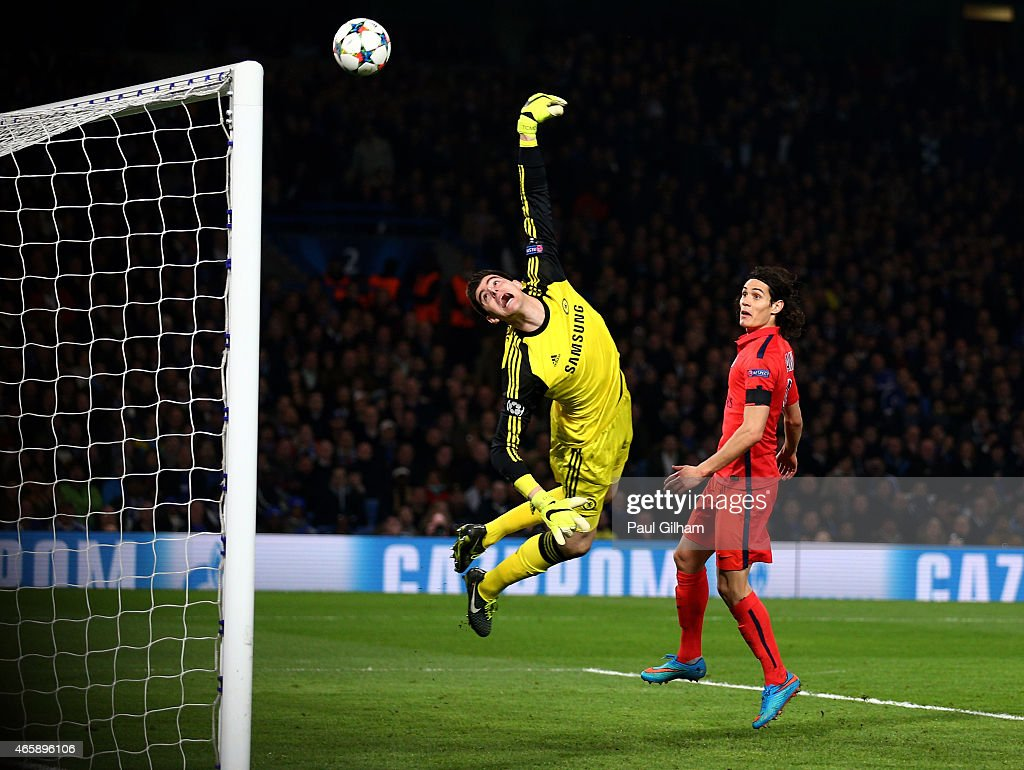 Goalkeeper Thibaut Courtois of Chelsea dives in vain as the header from Thiago Silva (not seen) of PSG flies into his net to level the scores at 2-2 during the UEFA Champions League Round of 16, second leg match between Chelsea and Paris Saint-Germain at Stamford Bridge on March 11, 2015 in London, England.