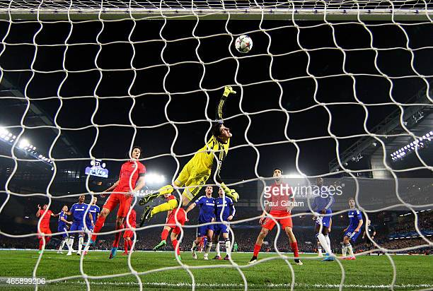 Goalkeeper Thibaut Courtois of Chelsea dives in vain as the header from Thiago Silva of PSG flies into his net to level the scores at 22 during the...