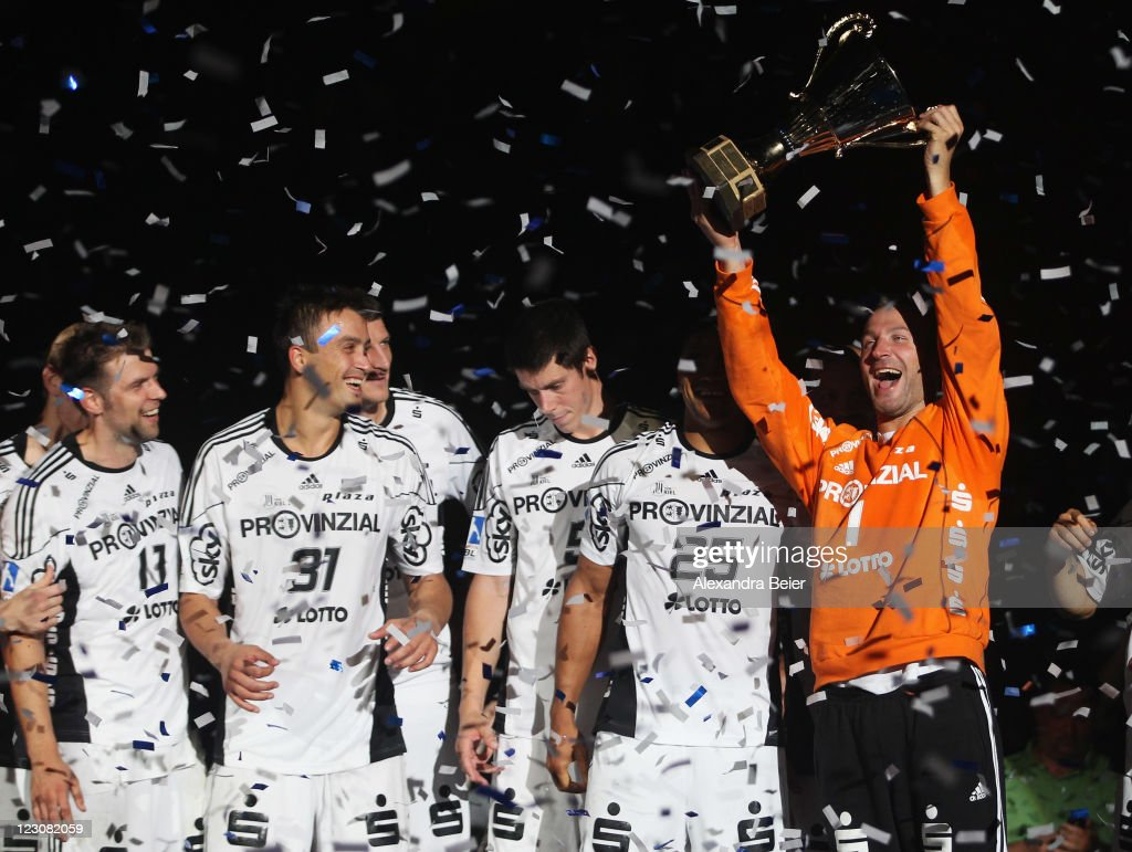 Goalkeeper <a gi-track='captionPersonalityLinkClicked' href=/galleries/search?phrase=Thierry+Omeyer&family=editorial&specificpeople=853674 ng-click='$event.stopPropagation()'>Thierry Omeyer</a> (R) of Kiel celebrates his team's victory with teammates after winning the Handball Supercup match between HSV Hamburg and THW Kiel on August 30, 2011 in Munich, Germany.