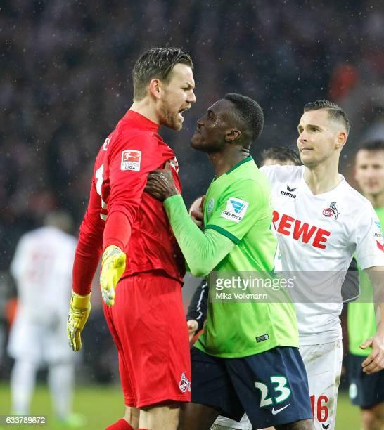 Goalkeeper Thomas Kessler of Cologne and Josuha Guilavogui of Wolfsburg argue during the Bundesliga match between 1 FC Koeln and VfL Wolfsburg at...