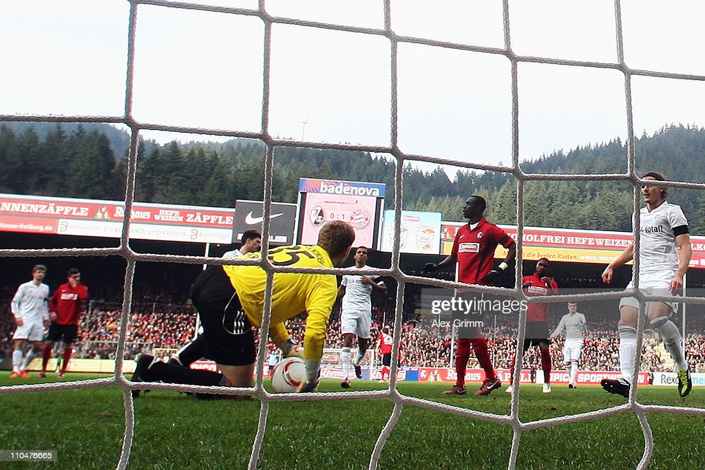 Goalkeeper Thomas Kraft of Muenchen reacts after saving a penalty by Papiss Demba Cisse of Freiburg during the Bundesliga match between SC Freiburg and Bayern Muenchen at Badenova Stadium on March 19, 2011 in Freiburg im Breisgau, Germany.