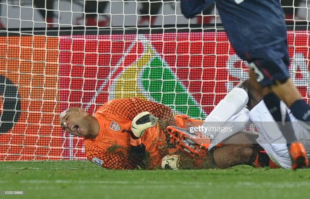 US goalkeeper <a gi-track='captionPersonalityLinkClicked' href=/galleries/search?phrase=Tim+Howard+-+Soccer+Player&family=editorial&specificpeople=11515558 ng-click='$event.stopPropagation()'>Tim Howard</a> (R) grimaces after a clash with England's striker Emile Heskey during the Group C first round 2010 World Cup football match England vs. USA on June 12, 2010 at Royal Bafokeng stadium in Rustenburg. NO