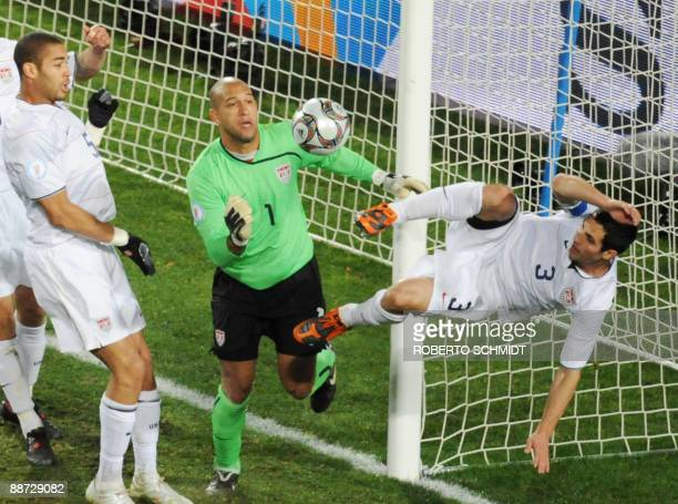 US goalkeeper Tim Howard looks at the ball shot by Brazilian midfielder Kaka next to US defender Carlos Bocanegra during the Fifa Confederations Cup...