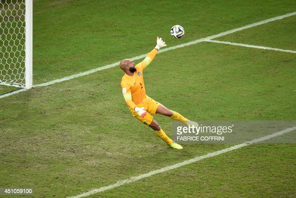 US goalkeeper Tim Howard makes a save during a Group G football match between USA and Portugal at the Amazonia Arena in Manaus during the 2014 FIFA...