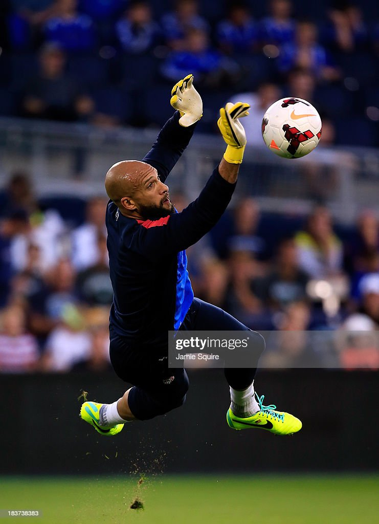 Goalkeeper <a gi-track='captionPersonalityLinkClicked' href=/galleries/search?phrase=Tim+Howard+-+Soccer+Player&family=editorial&specificpeople=11515558 ng-click='$event.stopPropagation()'>Tim Howard</a> makes a save during a training session for the US Men's National Soccer Team in advance of their game vs Jamaica at Sporting Park on October 9, 2013 in Kansas City, Kansas.
