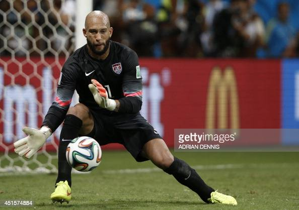 US goalkeeper Tim Howard makes a save during extratime in the Round of 16 football match between Belgium and USA at The Fonte Nova Arena in Salvador...
