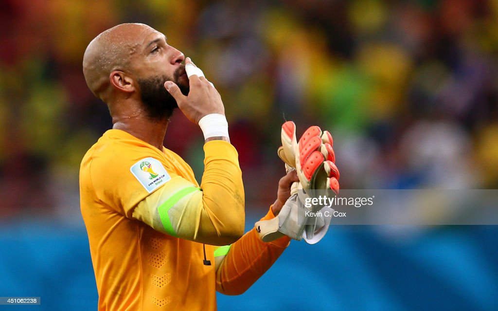 Goalkeeper <a gi-track='captionPersonalityLinkClicked' href=/galleries/search?phrase=Tim+Howard+-+Soccer+Player&family=editorial&specificpeople=11515558 ng-click='$event.stopPropagation()'>Tim Howard</a> of the United States acknowledges the fans after a 2-2 draw in the 2014 FIFA World Cup Brazil Group G match between the United States and Portugal at Arena Amazonia on June 22, 2014 in Manaus, Brazil.