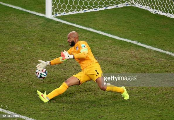 Goalkeeper Tim Howard of the United States makes a save during the 2014 FIFA World Cup Brazil Group G match between the United States and Portugal at...