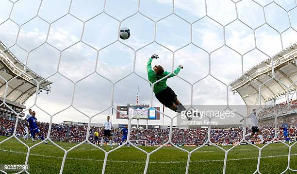 Goalkeeper Tim Howard of the United States stretches attempts to reach a goal strike by Christian Castillo of ElSalvador in the first half during the...