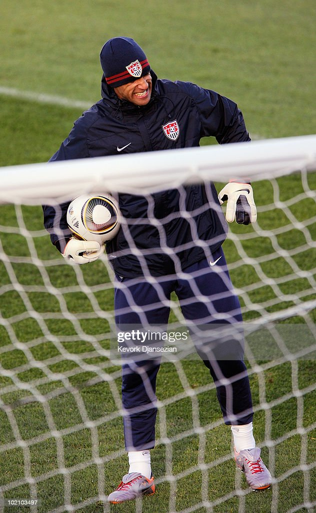 Goalkeeper Tim Howard of US national football team grimaces as he warms up during training session on June 15, 2010 in Pretoria, South Africa. Howard has been cleared to play when US will play their next World Cup Group C match against Slovenia on Friday June 18, 2010.