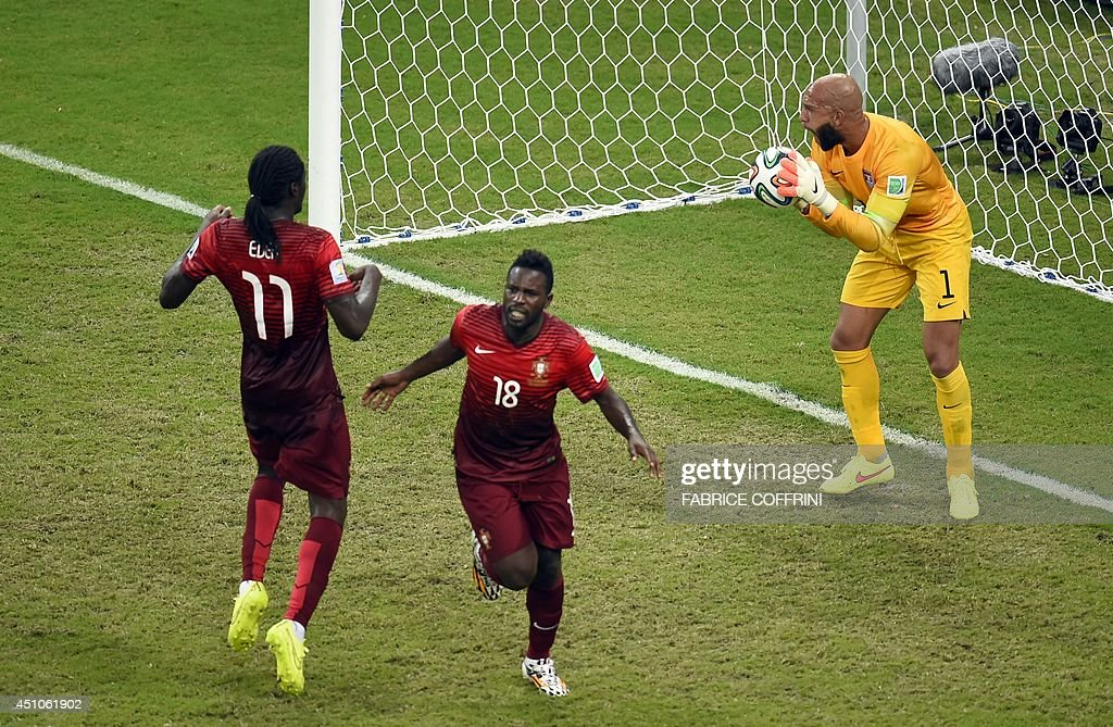 US goalkeeper <a gi-track='captionPersonalityLinkClicked' href=/galleries/search?phrase=Tim+Howard+-+Soccer+Player&family=editorial&specificpeople=11515558 ng-click='$event.stopPropagation()'>Tim Howard</a> (R) reacts after Portugal's forward <a gi-track='captionPersonalityLinkClicked' href=/galleries/search?phrase=Silvestre+Varela&family=editorial&specificpeople=607288 ng-click='$event.stopPropagation()'>Silvestre Varela</a> (C) scored during a Group G football match between USA and Portugal at the Amazonia Arena in Manaus during the 2014 FIFA World Cup on June 22, 2014. AFP PHOTO / FABRICE COFFRINI