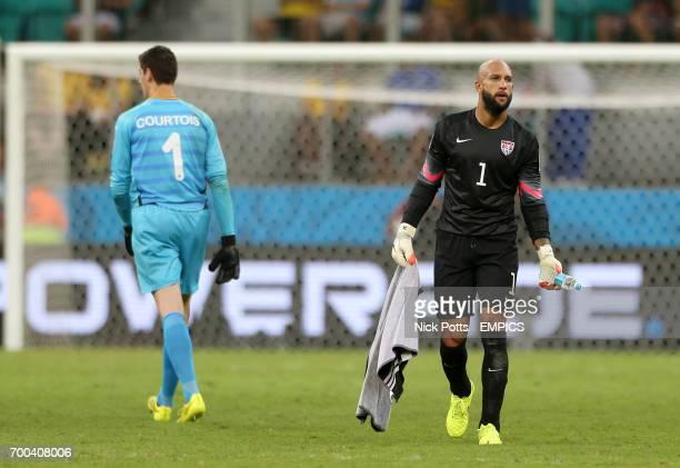 USA goalkeeper Tim Howard walks past Belgium goalkeeper Thibaut Courtois after the game