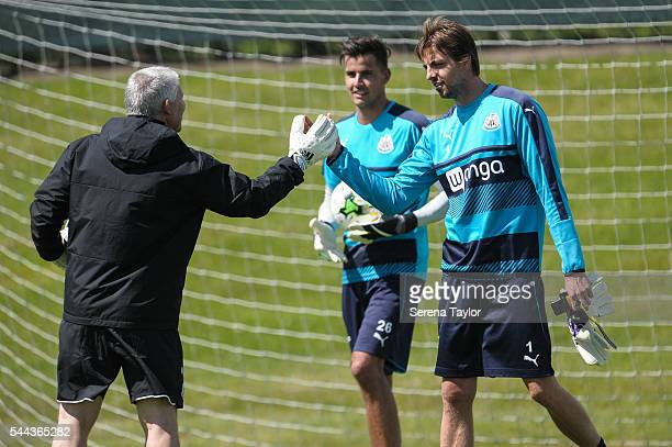 Goalkeeper Tim Krul greets Goalkeeping coach Simon Smith during a Newcastle United training session at The Newcastle United Training Centre on July 3...