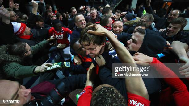 Goalkeeper Tim Krul of AZ Alkmaar celebratres with team mates after saving the final penalty in the shoot out to win the Dutch KNVB Cup Semifinal...