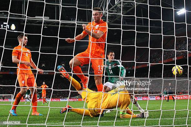 Goalkeeper Tim Krul of Netherlands saves the shot from Javier Hernandez of Mexico during the international friendly match between Netherlands and...