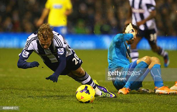 Goalkeeper Tim Krul of Newcastle United brings down Matej Vydra of West Bromwich Albion leading to a penalty during the Barclays Premier League match...