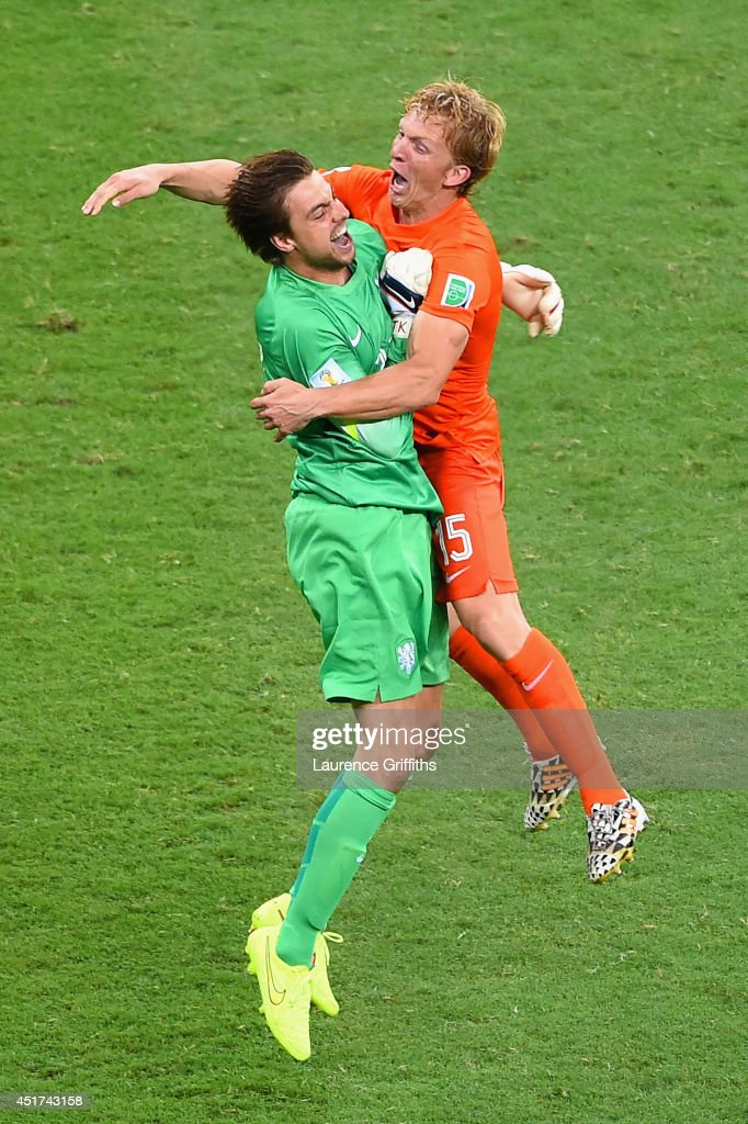 Goalkeeper Tim Krul of the Netherlands and Dirk Kuyt celebrate after defeating Costa Rica in a penalty shootout during the 2014 FIFA World Cup Brazil...