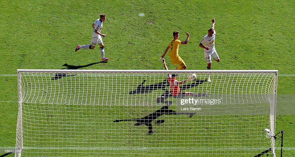Goalkeeper Tim Krumpen of Aachen saves a shoot of Luuk de Jong of Moenchengladbach during the first round match of the DFB Cup between Alemannia Aachen and Borussia Moenchengladbach at Tivoli Stadium on August 18, 2012 in Aachen, Germany.