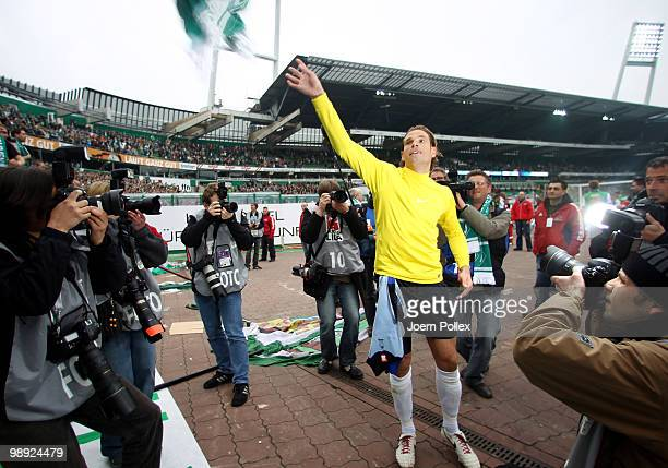 Goalkeeper Tim Wiese of Bremen celebrates with the fans after the Bundesliga match between SV Werder Bremen and Hamburger SV at Weser Stadium on May...