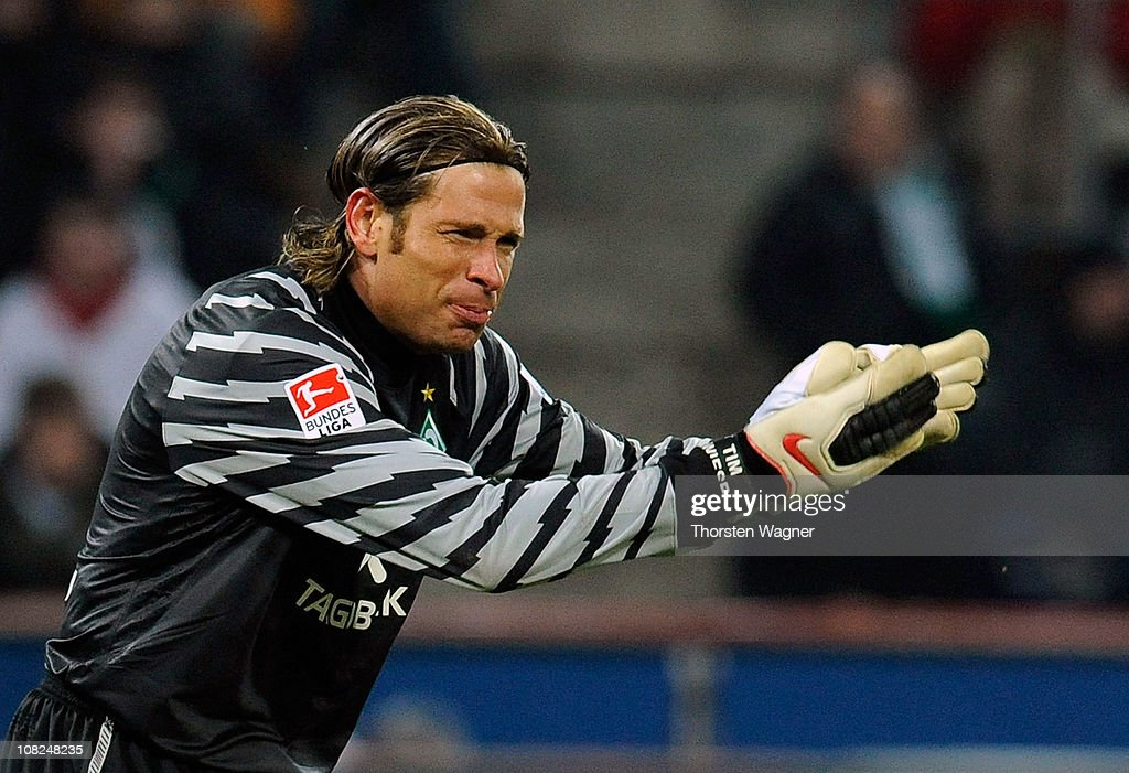 Goalkeeper <a gi-track='captionPersonalityLinkClicked' href=/galleries/search?phrase=Tim+Wiese&family=editorial&specificpeople=635015 ng-click='$event.stopPropagation()'>Tim Wiese</a> of Bremen gestures during the Bundesliga match between 1.FC Koeln and SV Werder Bremen at RheinEnergieStadion on January 22, 2011 in Cologne, Germany.